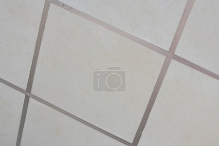 Old Texture of white panels for suspended ceiling.