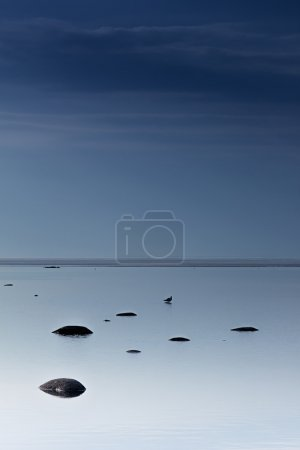 Cloudy blue minimalist seascape. Deserted space. Horizon line. Background.