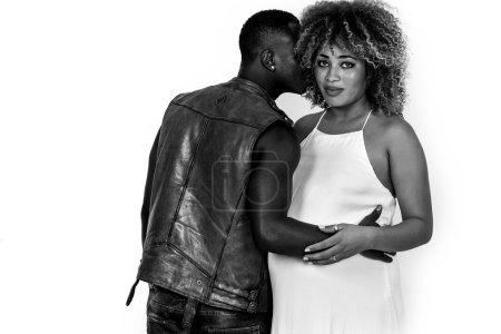African man portrait kissing on cheek his pregnant girlfriend mo