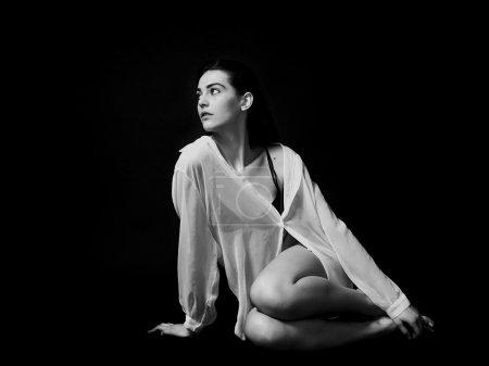 Gorgeous girl portrait wearing white transparent blouse black an