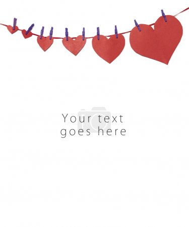 Hung red paper hearts greeting card