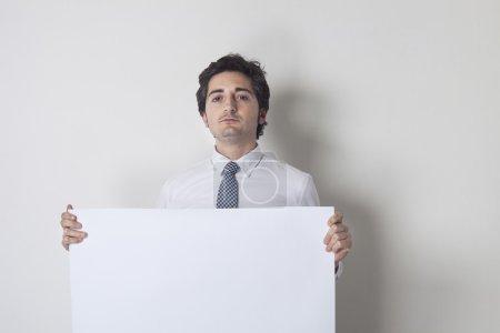 Man holding white blank billboard closeup