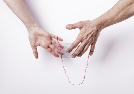 Photo for Woman and man with red string of fate - Royalty Free Image