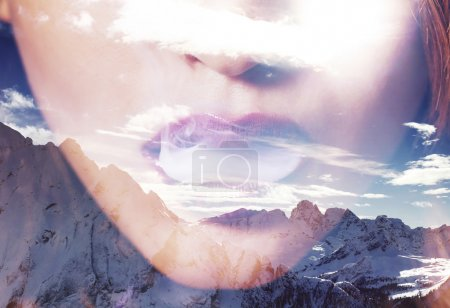 Double exposure of woman mouth smoking and mountainscape