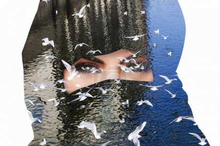 Double exposure of woman wearing burqa and seagulls