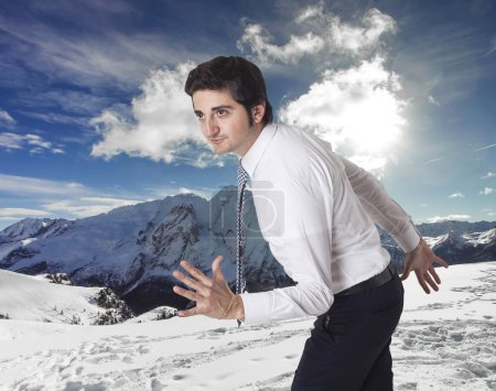 Determined businessman running towards mountain vacations