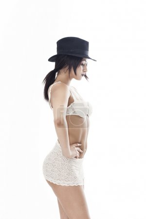 Profile woman portrait wearing white lingerie and black hat