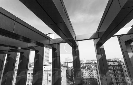 Cityscape seen from interior of modern building black and white