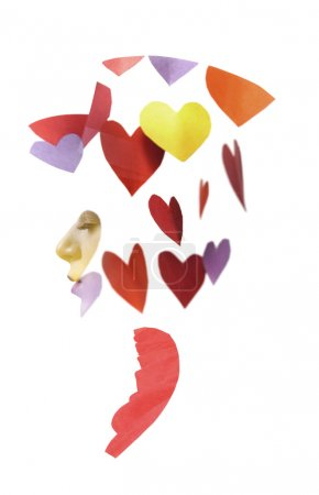Double exposure of girl wearing hat and colorful paper hearts