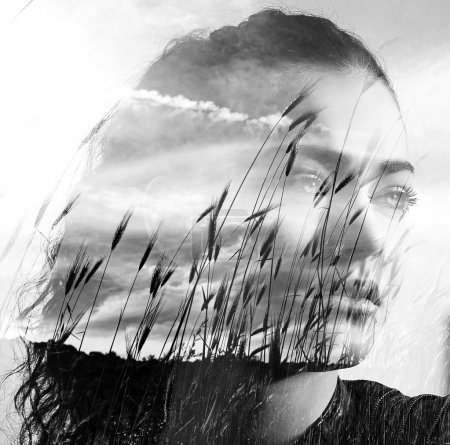 Double exposure of girl and wheat field black and white