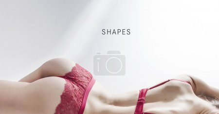 Sensual woman shapes wearing red lingerie
