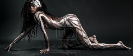 Sexy african model body painted with polygons letterbox