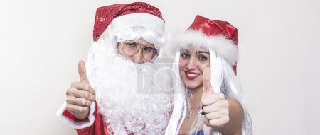 Female and male Santa Claus thumbs up letterbox
