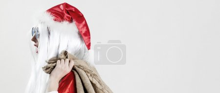 Photo for Santa Claus holding jute sack and going to work letterbox - Royalty Free Image