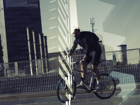 Double exposure of biker portrait and cityscape