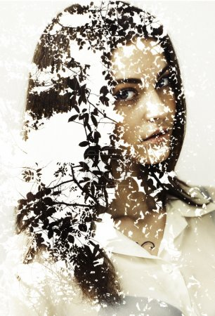 Double exposure of pretty girl and autumn leaves