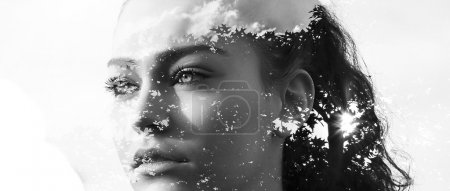 Double exposure of beautiful girl and leaves monochrome letterbo