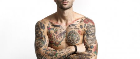 Photo for Handsome and sexy tattooed man portrait with crossed arms letterbox - Royalty Free Image