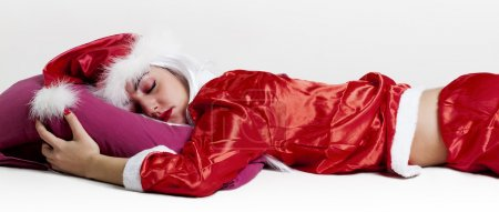 Tired female Santa Claus sleeping face down letterbox