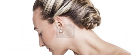 Pretty girl with braided hairstyle looking down letterbox