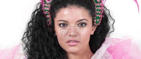 Beautiful samba dancer wearing traditional costume and looking l