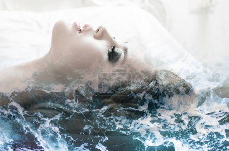 Double exposure of girl profile portrait and sea foam texture