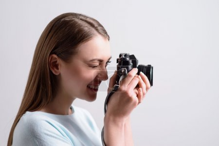 Positive smiling girl making photos