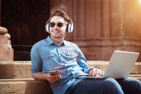 Smiling handsome guy listening to music