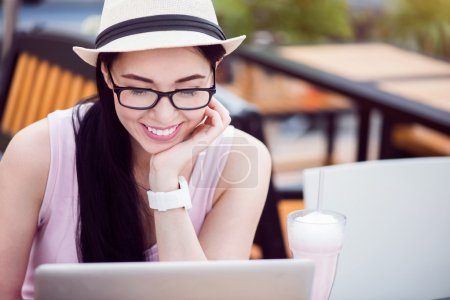Cheerful woman using laptop