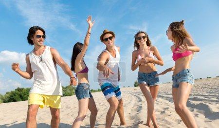 Joyful friends having fun on the beach