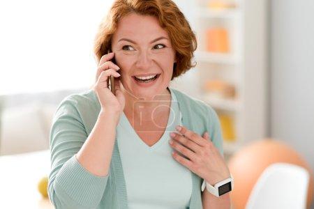 Cheerful senior woman talking on cell phone