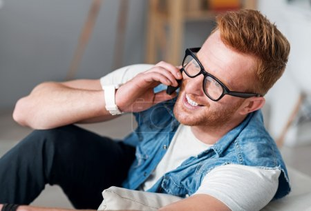Positive man talking on cell phone