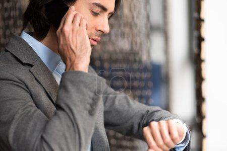 Pleasant man talking on smart phone