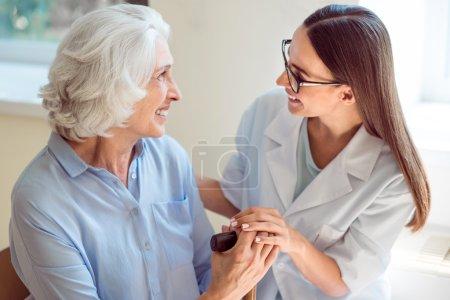 Young nurse helping senior patient