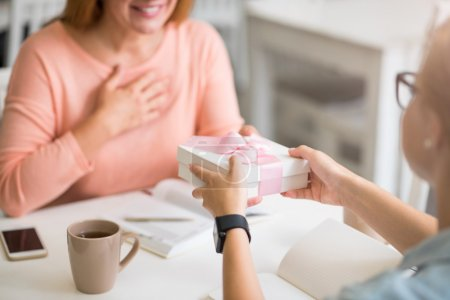 Positive woman getting present