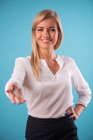 Lovely blonde wearing white blouse