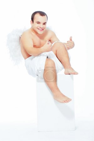 Little angel with white wings posing