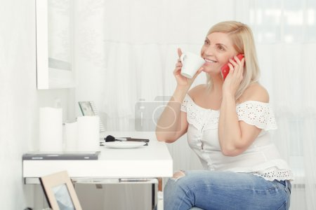 Woman speaks over the phone