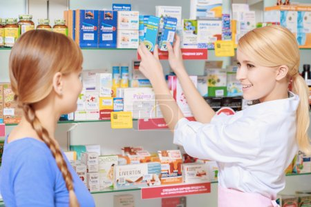 Pharmacist and a customer choosing medicine