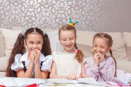 Schoolgirls do home tasks together