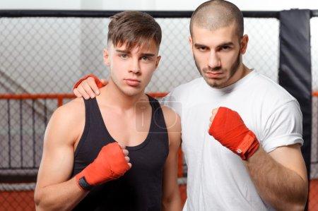 Sportsmen training in a gym