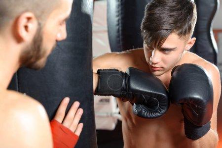 Boxing coach trains his team
