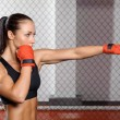 Jab. Young strong and fit woman training her jab i...