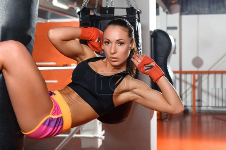Fitness trainer does workout