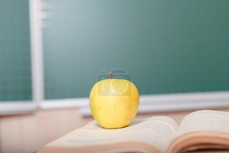 Apple put on opened book