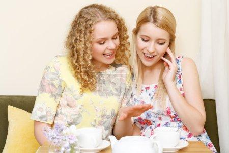 Two women examining wedding ring