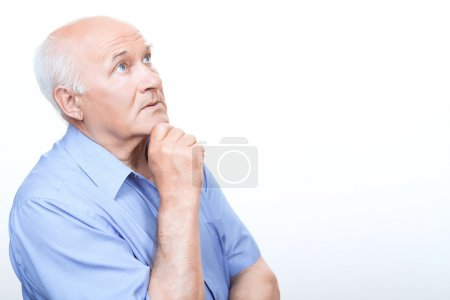 Reflective grandfather involved in thinking