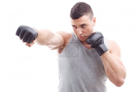 Muscled guy during workout