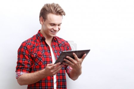 Pleasant guy surfing through the Internet