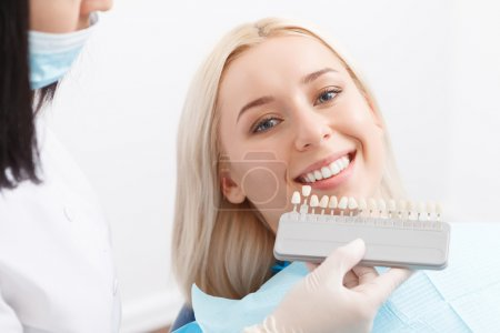Woman by dentist and doctor matching filling